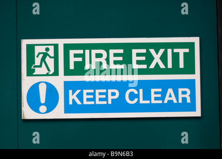 Keep clear fire exit sign Manchester city centre UK - Stock Photo