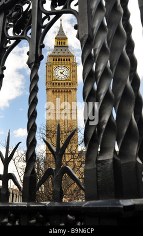 Westminster Clock Tower through railings around Houses of Parliament - Stock Photo