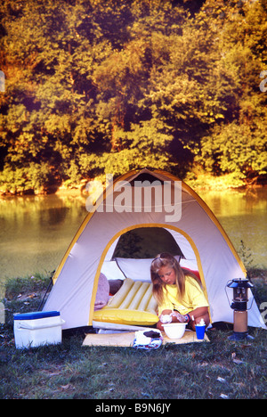 Camping' by the River at Sunset - Stock Photo