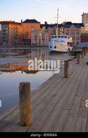 A travel boat at pier in Helsinki, Finland. - Stock Photo