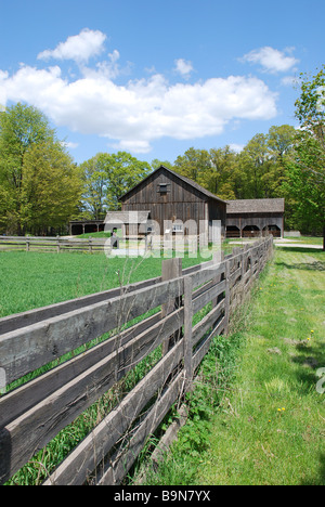 Rural landscape with green fields and farm house - Stock Photo