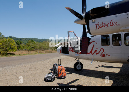 Small Nature Air propeller plane on runway, Drake Bay, Costa Rica.