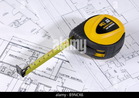Measuring tape and construction plans - Stock Photo