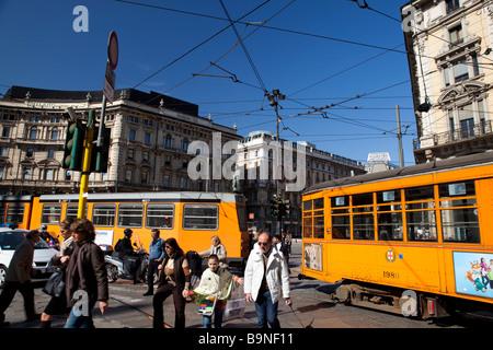 Milano, Piazza Cordusio. Pedestrians and public trams. Italy - Stock Photo