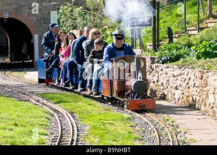 Live steam loco taking families round a 5' guage model railway track at Broomy Hill, Hereford Society of Model Engineers, - Stock Photo
