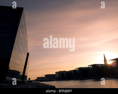 Sunrise in Copenhagen, Denmark.  The Royal Library is at the left, while the buildings of Christianshavn are at - Stock Photo