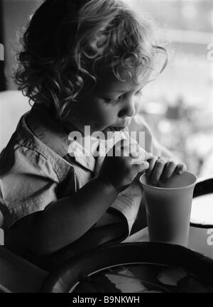 Young child drinking - Stock Photo