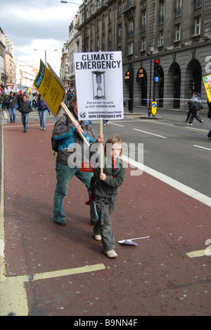 Child protester placard Anti capitalist G20 Protest March London 2009 - Stock Photo
