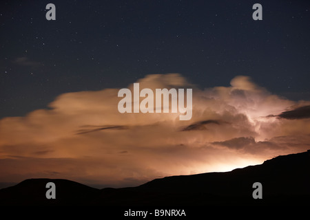 thunderstorms, lightening and stars over the Drakensberg Mountains, KwaZulu Natal, South Africa - Stock Photo