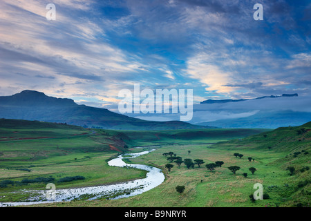 a moody evening sky over the Tugela Valley with the Drakensberg Mountains beyond, KwaZulu Natal, South Africa - Stock Photo