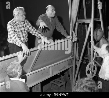 Art director Sergei Obraztsov left and actor Semyon Samodur right at a rehearsal at the Central Puppet Theater - Stock Photo