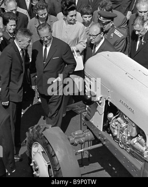 President Josip Broz Tito of the Socialist Federative Republic of Yugoslavia examines Belarus tractor model at Minsk - Stock Photo