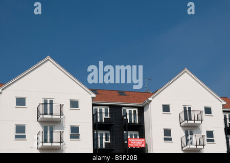 New Apartments sale modern housing architecture, red advertising sign, Romford Historic Market town, Essex, UK, - Stock Photo