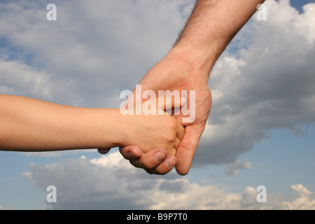 father's and son's hands - Stock Photo