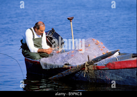 Israel, North district, Galilee, Sea of Galilee, Tabgha, fisherman collecting his nets - Stock Photo