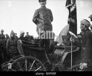 Mikhail Kalinin standing after presenting banner to First Cavalry Army near Uman - Stock Photo