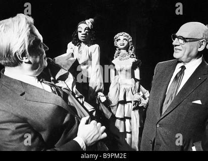 Sergei Obraztsov director of the State Central Puppet Theater left and famous US impresario Sol Hurok right who - Stock Photo