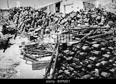 Helmets and weapons left behind after defeat of the Nazi troops near Sevastopol - Stock Photo