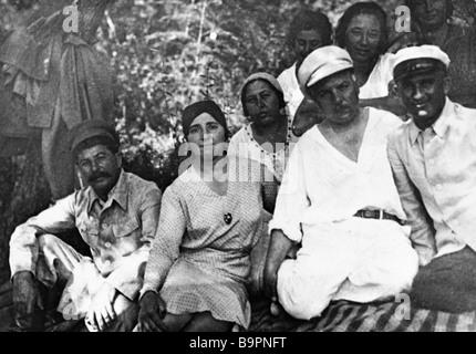 First row left to right Josef Stalin his wife Nadezhda Alliluyeva Kliment Voroshilov - Stock Photo