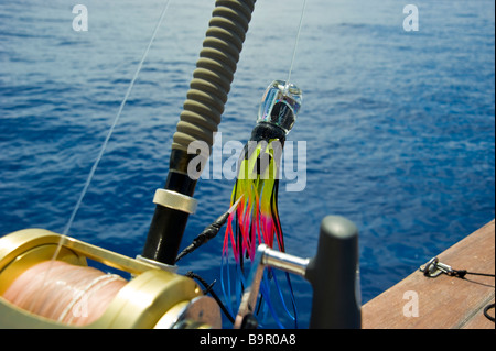 Big game fishing reel with lure on fishing boat La Réunion France   Hochsee-Angel mit Rolle und Köder auf Angelboot, - Stock Photo