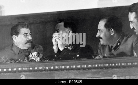 Josef Stalin left Kliment Voroshilov second from left Lazar Kaganovich second from right and Anastas Mikoyan right - Stock Photo