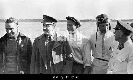 Josef Stalin second from left and Kliment Voroshilov far right meeting Valery Chkalov s crew at Shchelkovo Airport - Stock Photo