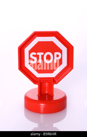 Stop sign toy against a white background - Stock Photo