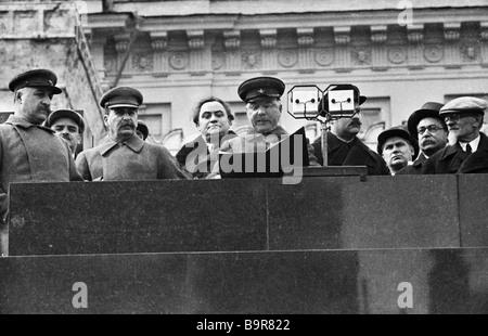 Sergo Ordzhonikidze Andrei Andreev Josef Stalin Georgy Dimitrov left to right Kliment Voroshilov speaking Lazar - Stock Photo