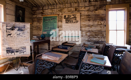 Desks in classroom Old Trail Town Cody Wyoming USA - Stock Photo