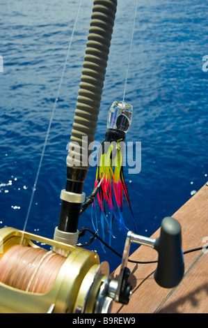 Big game fishing reel with lure on fishing boat La Réunion France | Hochsee-Angel mit Rolle und Köder auf Angelboot, - Stock Photo
