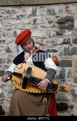 Rachael Frost (MR) plays Hurdy-gurdy,a stringed instrument, squat, pear-shaped fiddle, Hawick Reivers Festival, - Stock Photo