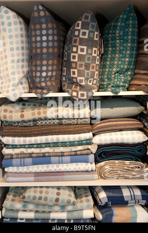 Cushions and fabric on sale at the shop in Melin Tregwynt welsh woollen mill Castlemorris Pembrokeshire wales UK - Stock Photo
