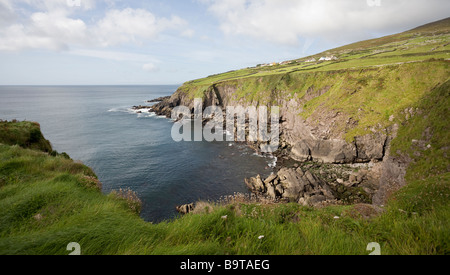View of a Rocky Cove from the Fort. A rocky cove with pasture and small cottages above is typical of many around - Stock Photo