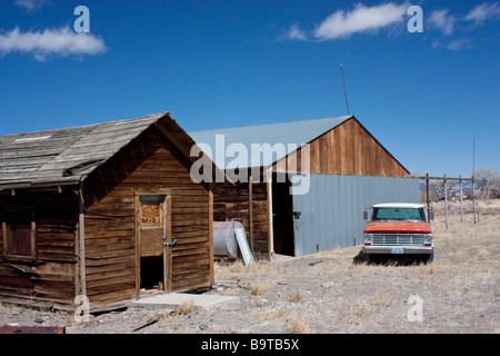 Old Shack Old Truck and Old barn in the Nevada desert - Stock Photo
