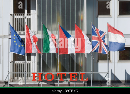 hotel front with international flags - Stock Photo