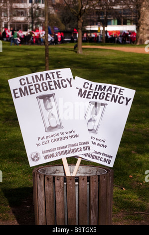 Climate Emergency Signs in a bin - Stock Photo
