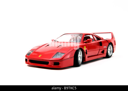 Miniature replica of a red Ferrari F40 model car made by model car manufacturer Bburago on white background - Stock Photo