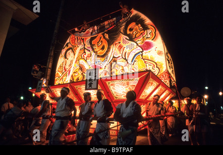 Participants pull festival float through city streets during the Neputa festival in Hirosaki Japan - Stock Photo