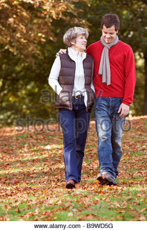Mother and son having a discussion in autumn park - Stock Photo