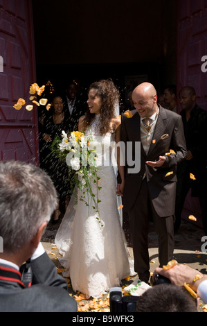 Rose petals thrown over bride and groom outside church wedding marriage Rennes Brittany France Europe - Stock Photo