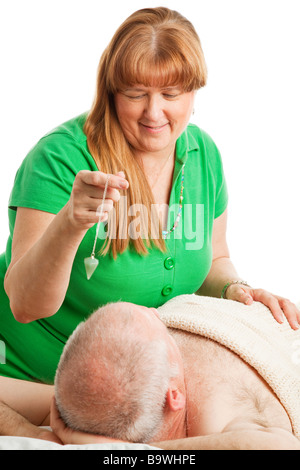 Healing touch practitioner using crystal therapy to unblock her patient s chakras  - Stock Photo
