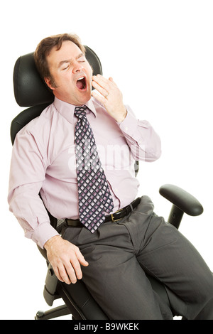 Businessman yawns in his comfortable ergonomic office chair Isolated on white  - Stock Photo