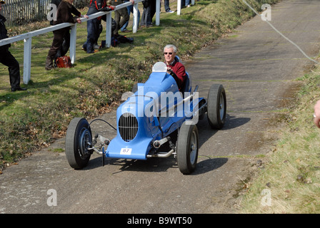 A 1937 Stafford Special Peter Colborne Baber descending at speed on the Brooklands Museum Test Hill Challenge celebrating - Stock Photo