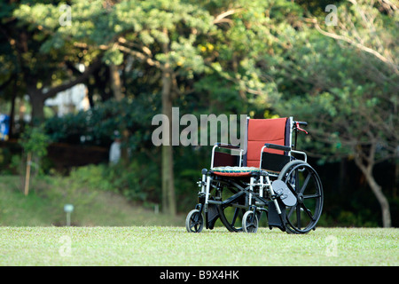 Empty wheelchair parked in park, health care concept, Taiwan - Stock Photo