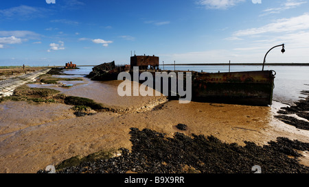 A panoramic view of abandoned boats beached on the banks of the River Roach near Paglesham in Essex. - Stock Photo