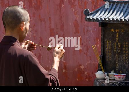 Prayer at the Jade Emperor Pagoda Buddhist temple in Ho Chi Minh City Vietnam - Stock Photo