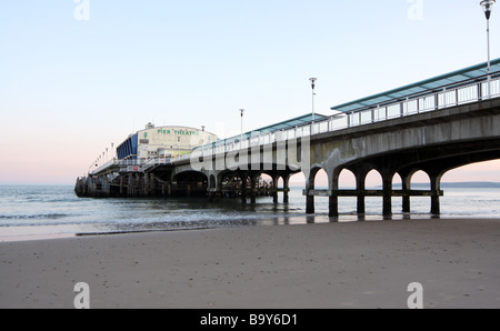 Bournemouth Pier at sunset from the beach - Stock Photo
