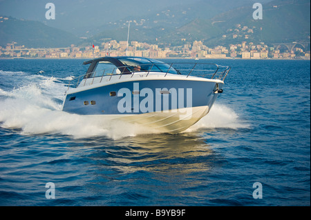 Sealine SC 47 powerboat cruising in the Mediterranean sea in front of the ligurian coast near Genua Italy Sportboot - Stock Photo