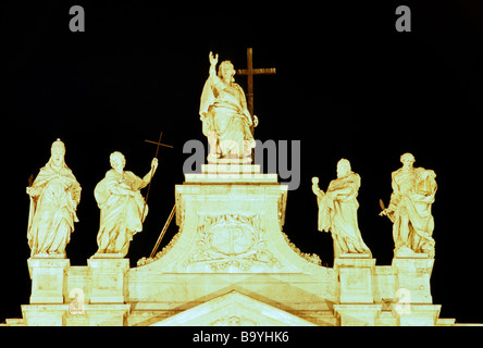 Colossal statues on the top of the façade of the Basilica di San Giovanni in Laterano in Rome. - Stock Photo