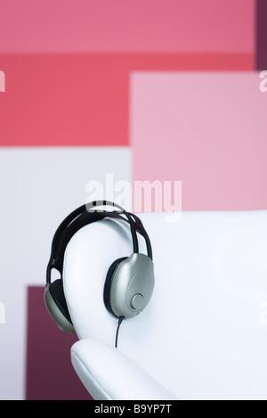 Headphones on arm of sofa - Stock Photo